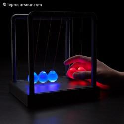 Balancier de Newton lumineux